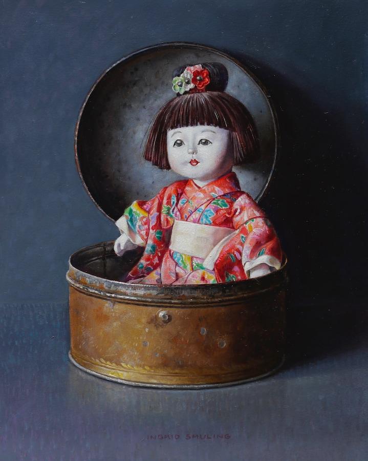 Chinees popje in oude trommel