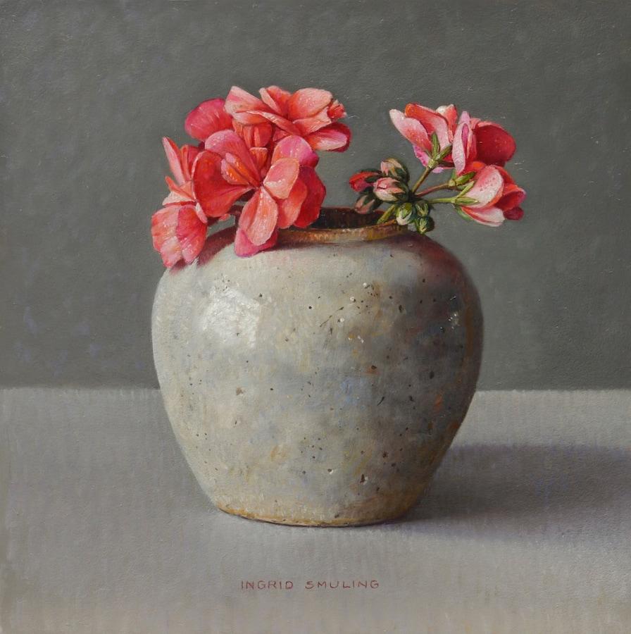 Oranjerode geranium in gemberpot